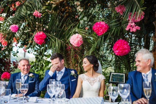 Embarrassed groom during speeches
